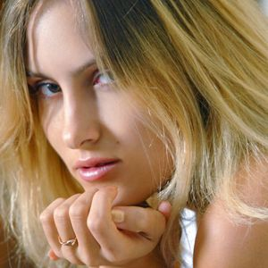 Versaute junge Frau blond